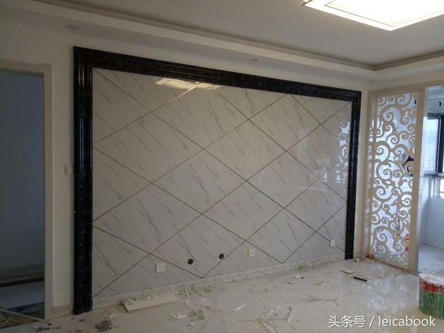 1,边框用uv板和茶色玻璃搭配,中间菱形造型铺贴