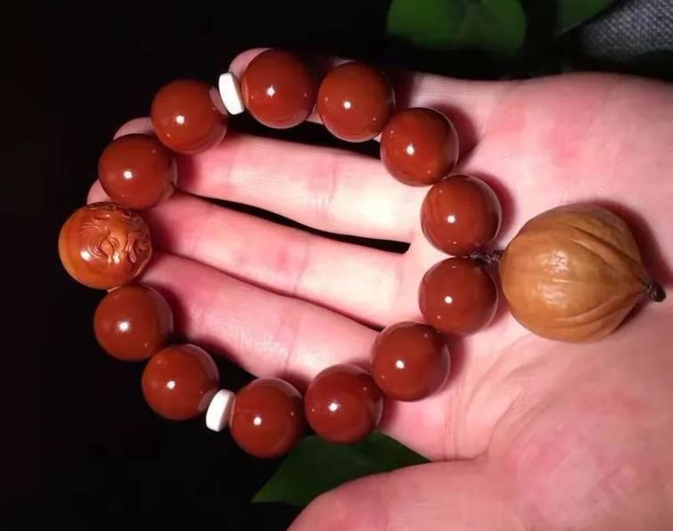 正圆橄榄核包浆囹�a_橄榄核包浆非常漂亮,完美的橄榄核包浆后的美观度丝毫不亚于南红(一